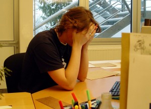 Image of a man with stress associated with cultural adjustment